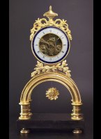 Gilded case, enamel dialplate with bleu ring. H=41cm, W=22cm