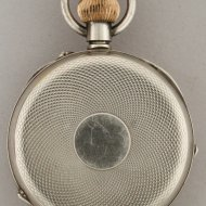 Silver pocket watch with day, date, month and moonday indication.