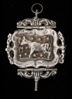 Dutch silver large, caged and repoussé key with two hinges. On one side a cow and on the other side a man on a horse.