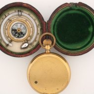 Pocket altimeter with thermometer and compass in box.