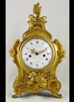 Gilded brass casted french clock with verge movement, signed on dial and movement 'G.J. Champion à Paris'. Original gilding.