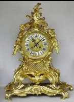 Bronze casted mantel clock in Louis XV style.