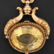 golden pocket watch key with citrine