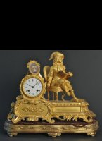 Firegilded bronze clock with detailed representation and Sèvre porcelan portret. Has gilded wooden basement.