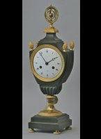 French vase clock. partly firegilded and patinated, armillery sphere on top, 8-day movement with silk suspension pendulum.